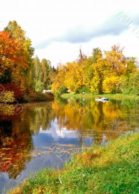 Picturesque pond in autumn day