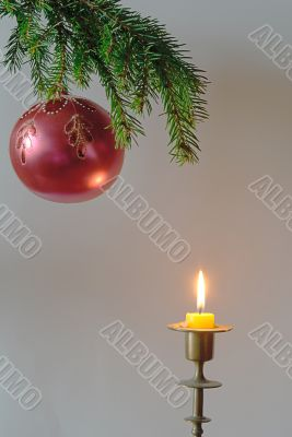 fir-tree  twig and red bal with candle