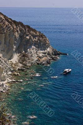 Sea view with rocks and boat
