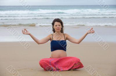Beautiful pregnant girl practicing yoga