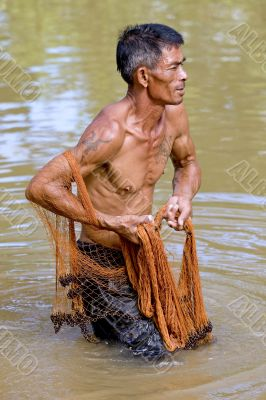 Fisherman of Thailand with throw net