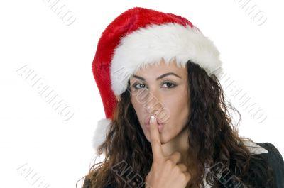christmas lady making silence sign