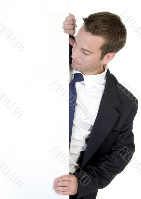 businessman posing with white banner