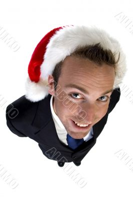 caucasian businessman with santa cap
