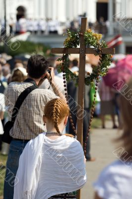 Young girl standing with cross