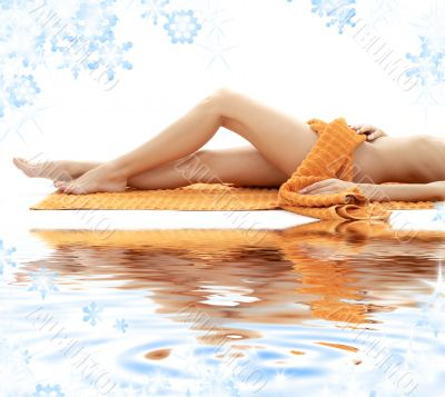 long legs of relaxed lady with orange towel