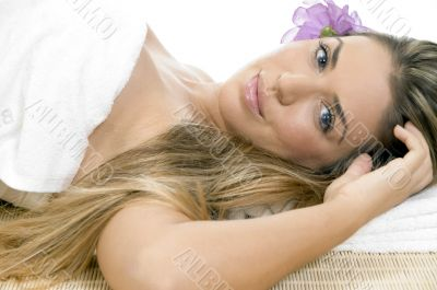 relaxing blonde model looking you