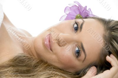 laying blonde model looking you