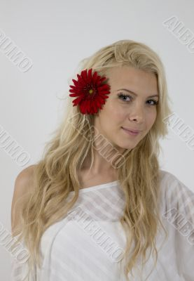 sensual lady with red flower in hair