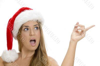 indicating sexy lady with santa cap