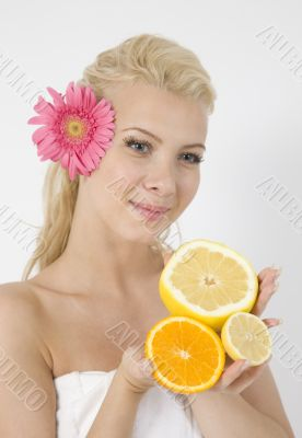 young lady with fruits and pink flower in hair
