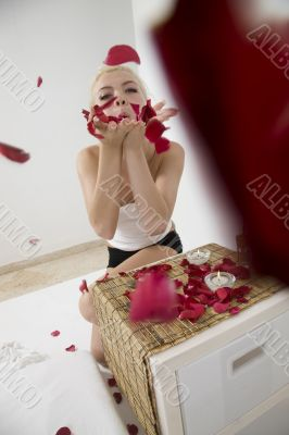 beautiful lady splattering petals