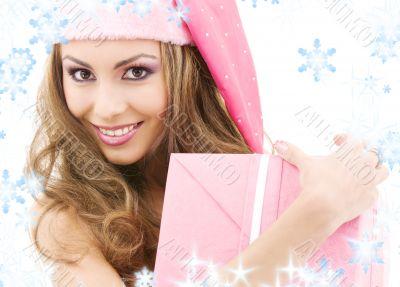 cheerful santa helper girl with gift box