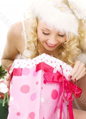 lovely santa helper girl with christmas gifts