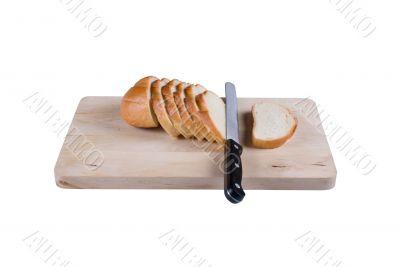 The cut bread on a chopping board.