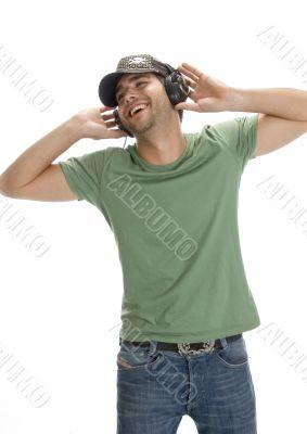 smiling man enjoying music