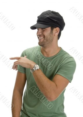 cheerful man with cap and watch
