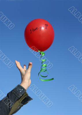 Flying red balloon with the words I love you
