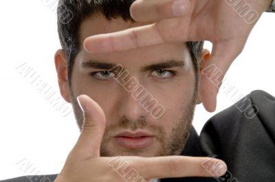 man showing framing hand gesture