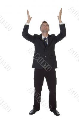man making wish with raised hands