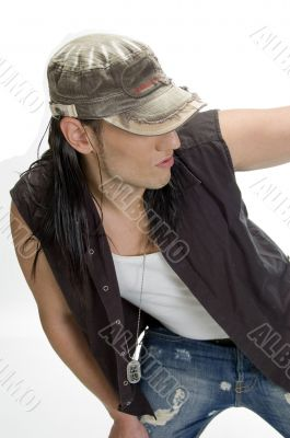 white model with cap and pendent