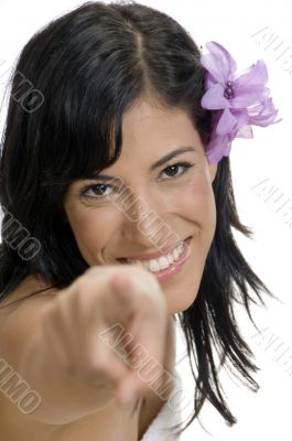 pointing woman looking to camera