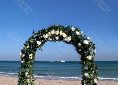 Arc of flowers during a wedding at the sea