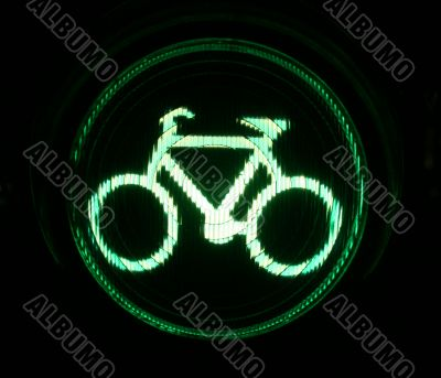 Green traffic light for bikers at night