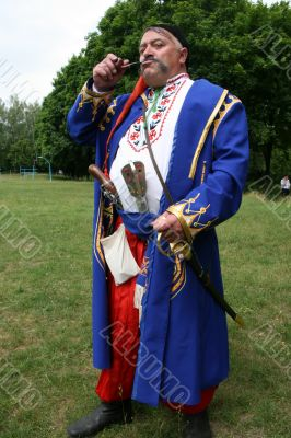 Old ukrainian Cossack with  whiskers and pipe