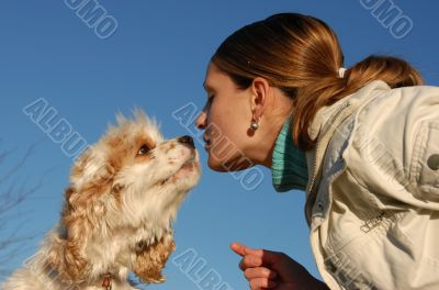 kissing woman and dog