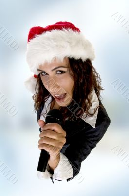 lady wearing christmas hat and singing