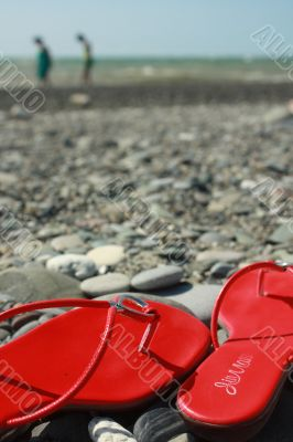 Red footwear on coast on distanc