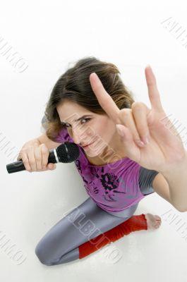 female with karaoke showing hand gesture