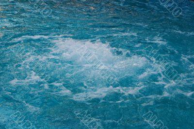 textured rippled deep blue water surface