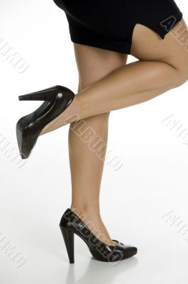 woman standing on one leg