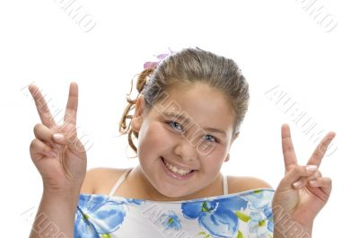 little girl gesturing peace sign