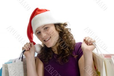 female with carry bags and santa cap