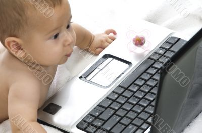cute baby playing with laptop