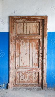 The closed old decayed door