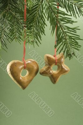 Christmas cookie hanging from fir branch