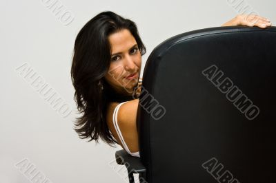 Latina sitting in chair