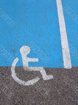 Logo on asphalt for disabled persons