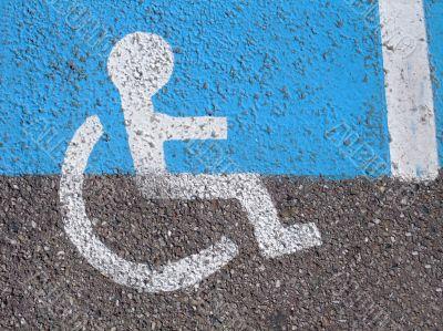 Logo on asphalt for disabled persons