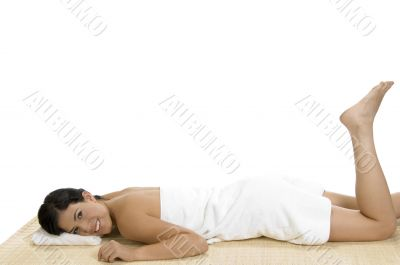 pleased woman laying on bamboo mat