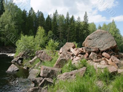 Boulders on a river bank