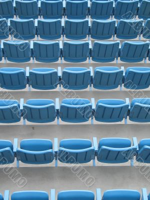 blue aligned plastic chairs