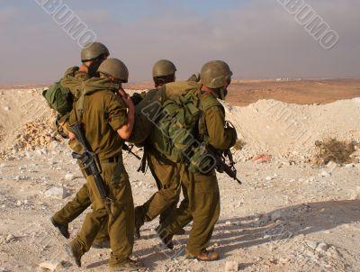 Israeli soldiers excersice in a desert