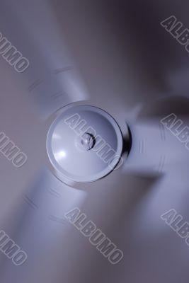 a modern white ceiling fan