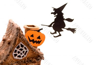 Witch,flying on broom on house,on white background