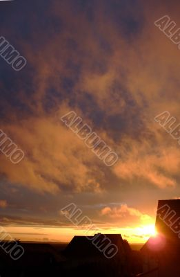 stratus clouds with orange reflection on sunset